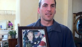 Brandon Keller holds a photograph of his brother Chandler, who was killed on Sept. 11, 2001. He was a passenger on Flight 77 which terrorists crashed into the Pentagon.