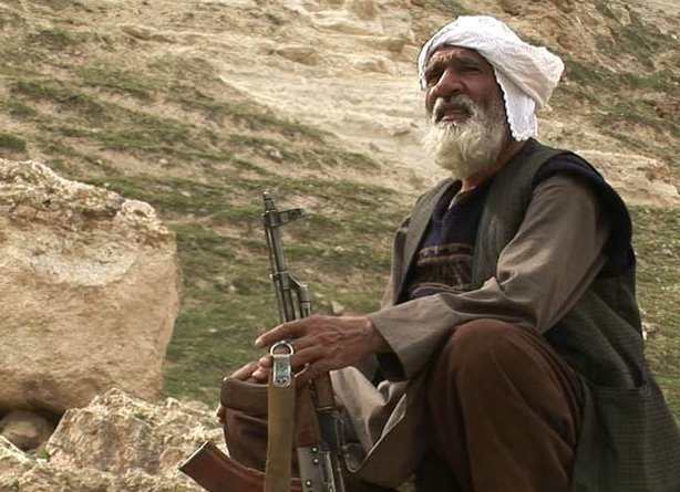 An Afghan Arab, known only as Khan, claims to be the regional commander for 3,000 to 4,000 Mujahidin in north central Afghanistan.