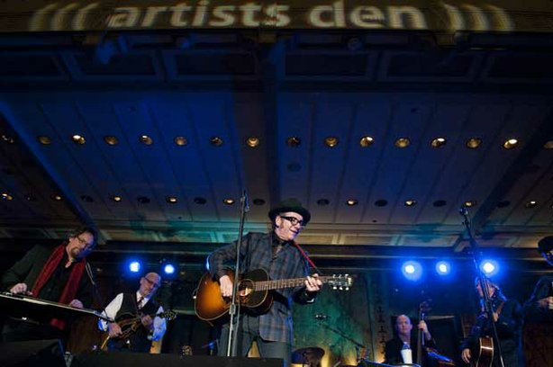 "(l to r): Jerry Douglas, Mike Compton, Elvis Costello, Dennis Crouch, Jim Lauderdale, and Jeff Taylor. The public television series ""Live From The Artists Den,"" features a performance by Elvis Costello and The Sugarcanes, recorded November 2, 2010 – the same day his latest album, ""National Ransom,"" was released – at the New York Public Library, New York, NY."