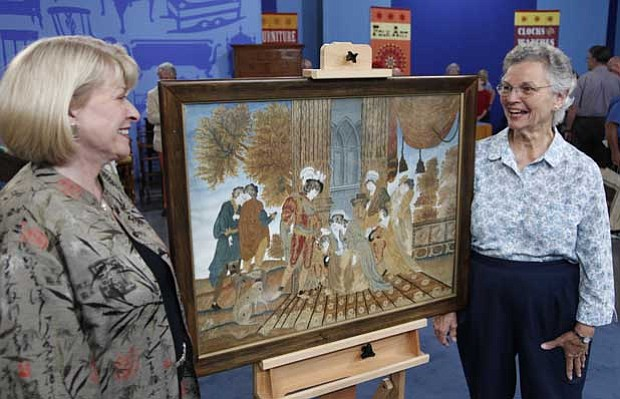 At the ANTIQUES ROADSHOW event in Biloxi, Mississippi, this guest (right) bri...