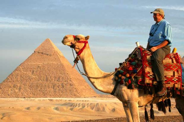 "On camel back, Richard Bangs visits the Great Pyramids of Giza near Cairo, Egypt, before sailing up the Nile River to the Valley of the Kings, Kom Ombo, and Lake Nasser in his ""Quest For The Lord Of The Nile"" through Egyptian history."
