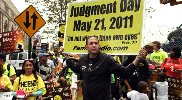 Participants in a movement that is proselytizing that the world will end this May 21, Judgment Day, gather on a street corner on May 13, 2011 in New York City.