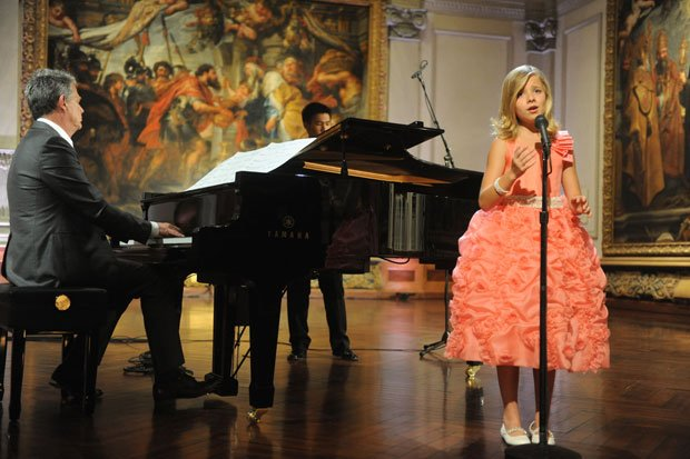 Jackie Evancho performs on stage  with co-host and music director David Foste...