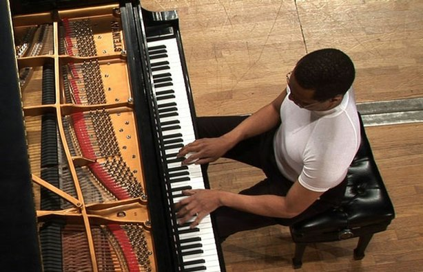 Henri-Robert Delbeau competes at the International Piano Competition for Outstanding Amateurs hosted by The Van Cliburn Foundation.