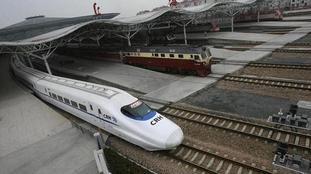 The CRH2 China Railways high-speed bullet train, departing a Shanghai station...