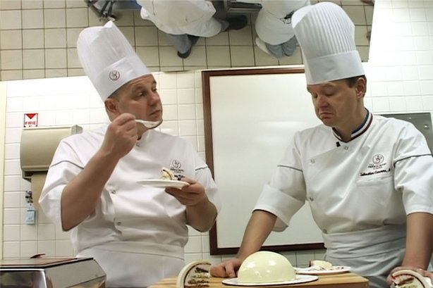"Chef Jacquy Pfeiffer and Chef Sebastien Canonne taste and discuss desserts in the kitchen as featured in ""Kings Of Pastry."""
