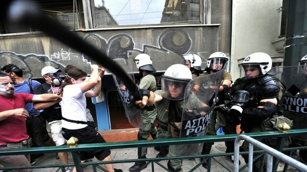 Protestors clash with riot police during a 48-hour general strike in Athens o...