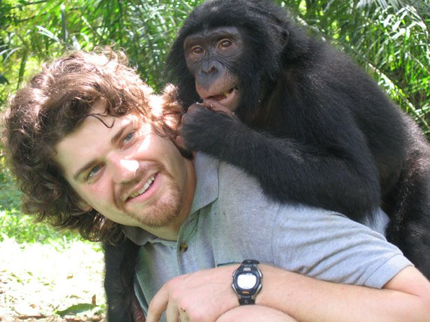 Brian Hare playing with a juvenile chimpanzee in Lola Ya Bonobo, Democratic R...