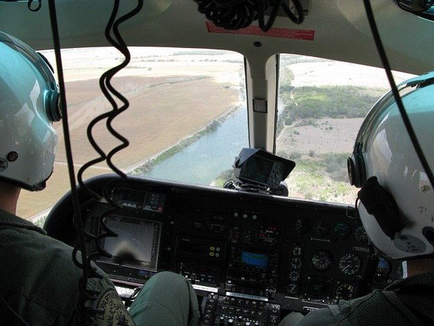 Texas Department of Public Safety pilots monitor the Rio Grande River near Lo...