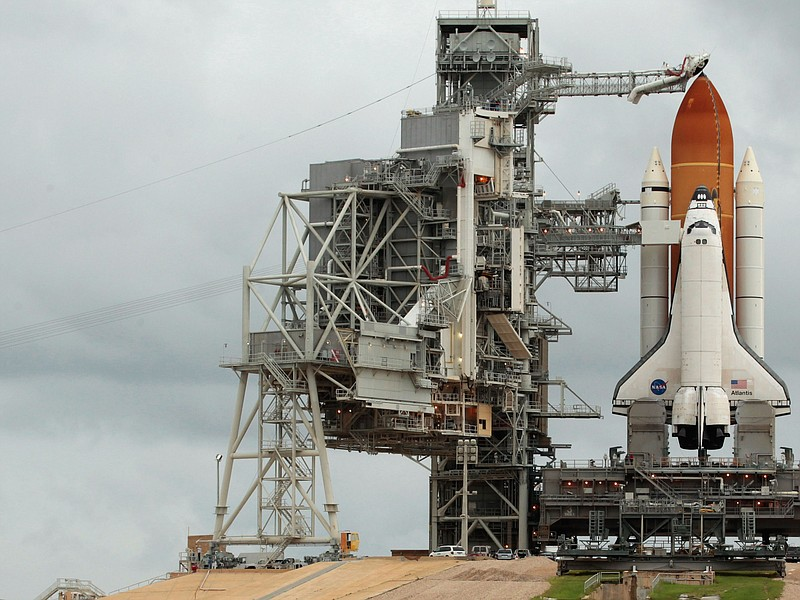 Hundreds of people gather near launch pad 39A to photograph and be photograph...