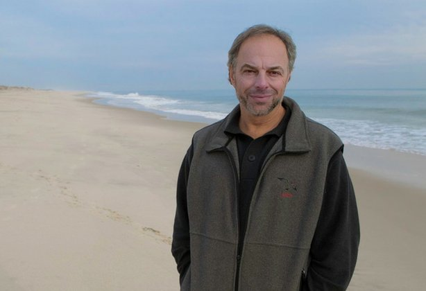 Marine biologist and best-selling author Carl Safina (pictured on the beach) ...