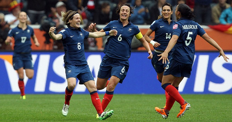 Sonia Bompastor (#8) of France celebrates after she scores her team's equaliz...
