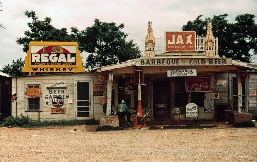 A crossroads business serves as store, bar, juke joint, and gas station in the cotton plantation area, Melrose, La., June 1940.