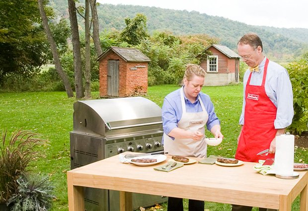 Test cook Julia Collin Davison and host Chris Kimball grill on the set of