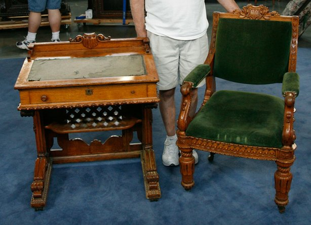 "At the ""Antiques Roadshow"" event in Spokane, Washington, this owner proudly displays an heirloom desk and chair used at the United States House of Representatives from 1857 to 1873. Rarely found together — with the desks being far scarcer than the chairs — the matched pair prompts appraiser Brian Witherell of Witherell's to estimate the set's combined value at $40,000."