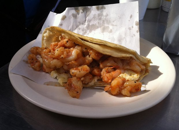 Promotional photo of a seafood taco as featured in