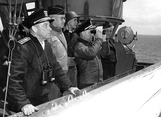 Normandy Invasion, June 1944. Senior U.S. officers watching operations from the bridge of USS Augusta (CA-31), off Normandy, June 8, 1944. They are (from left to right): Rear Admiral Alan G. Kirk, USN, Commander Western Naval Task Force; Lieutenant General Omar N. Bradley, U.S. Army, Commanding General, U.S. First Army; Rear Admiral Arthur D. Struble, USN, (with binoculars) Chief of Staff for RAdm. Kirk; and Major General Hugh Keen, U.S. Army.
