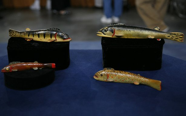 In Grand Rapids, Michigan, ANTIQUES ROADSHOW caught this school of wooden fish decoys, bought by the owner's father from renowned Michigan master carver Oscar Peterson. Peterson decoys are among the most coveted of American folk art objects; appraiser Ken Farmer values this collection at $14,000.