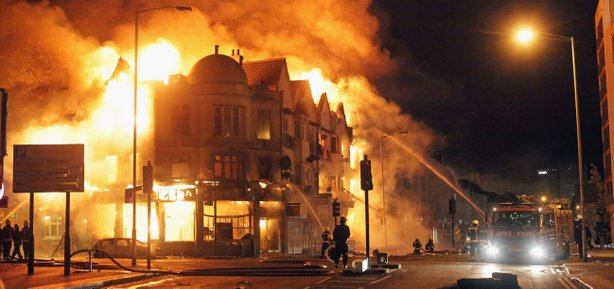 A large fire breaks out in shops and residential properties in Croydon on Aug...