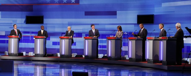 Republican presidential candidates pictured (L-R) former Pennsylvania Sen. Rick Santorum; businessman Herman Cain; Rep. Ron Paul, R-Texas, former Massachusetts Gov. Mitt Romney; Rep. Michele Bachmann, R-Minn.; former Minnesota Governor Tim Pawlenty; former Utah Gov. Jon Huntsman; former House Speaker Newt Gingrich during the Iowa GOP/Fox News Debate on August 11, 2011 at the CY Stephens Auditorium in Ames, Iowa.