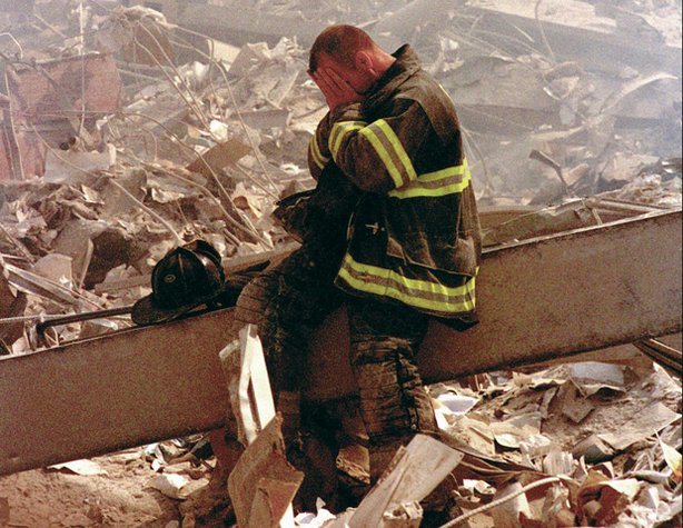 A fireman in despair at the slow pace of the search for survivors at Ground Zero.