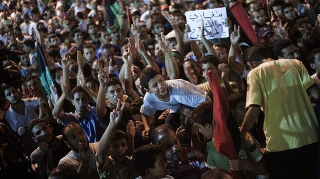 Tens of thousands of Libyans celebrate the partial fall of Tripoli in the han...