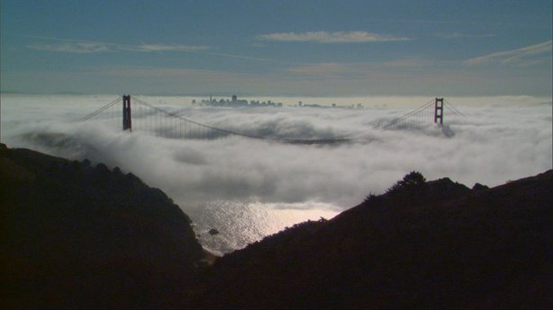 The Golden Gate Bridge and San Francisco skyline through the fog.