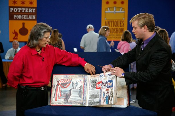 """At """"Antiques Roadshow"""" in Las Vegas, Nevada, this woman flips through a scrapbook, inherited from her great-great-grandfather, featuring the signatures of some of the Civil War era's greatest public figures, including Grant, Sherman, Frederick Douglass, Booker T. Washington, Robert E. Lee, Jefferson Davis and many others. This exceptional heirloom prompts appraiser Rafael Eledge of Shiloh Civil War Relics to assign an insurance value of $75,000 to $100,000."""