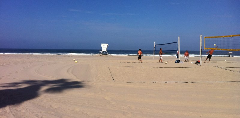 A few volleyball players are about the only people at Mission Beach after a s...