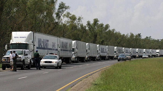 A convoy of Walmart trucks waited to enter New Orleans on Sept. 1, 2005, afte...