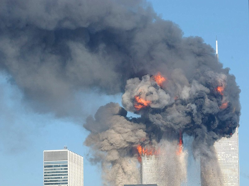 A fiery blasts rocks the World Trade Center after being hit by two planes Sep...
