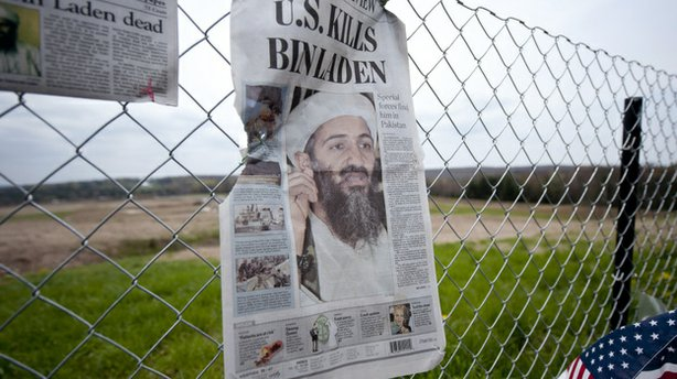 A newspaper left by visitors on May 2 in Shanksville, Pa., at the fence surro...