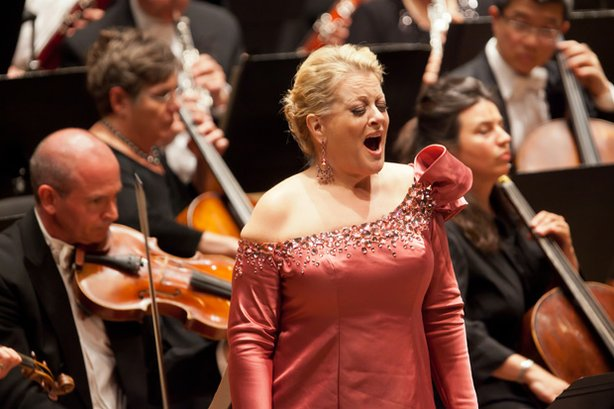 Soprano Deborah Voigt, pictured here performing with the New York Philharmonic on June 9, 2011, is returning for the orchestra's Opening Night Concert to sing music by Barber, Wagner and Richard Strauss in a concert led by Music Director Alan Gilbert.