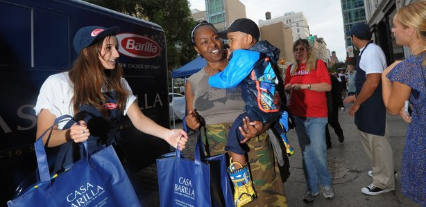 Barilla feeds thousands of New Yorkers free pasta dinners and donates 100,000 meals to Food Bank for New York City in Union Square on August 15, 2011.
