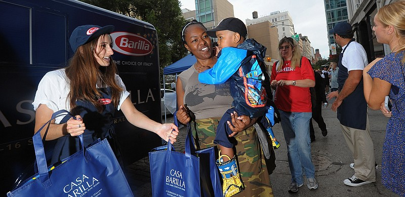 Barilla feeds thousands of New Yorkers free pasta dinners and donates 100,000...