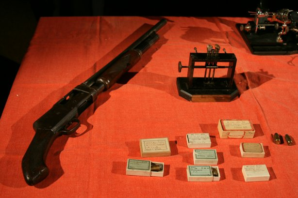 Table with gun and ballistics display. The St. Valentine's Day Massacre was o...