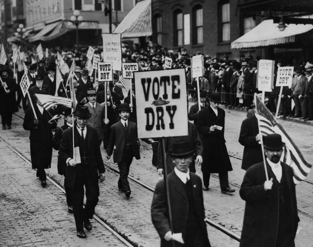 "Anti-Saloon League rally with ""Vote Dry"" signs. Women led the first campaigns for temperance, but later men, spurred by the Anti-Saloon League, rallied for dry laws in states throughout the country."
