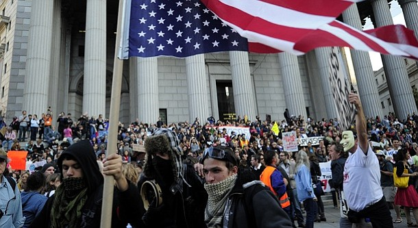 Occupy Wall Street protestors and union members stage a protest near Wall Str...