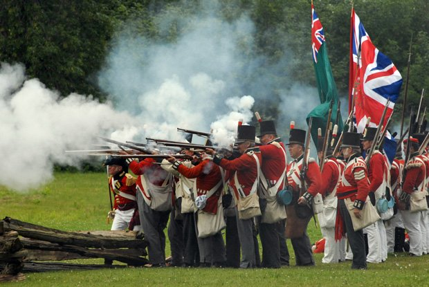 "British in firing formation letting loose the ""fog of war,"" in a re-enactment..."