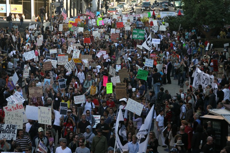 A large crowd marches as part of 'Occupy San Diego' in downtown San Diego on ...