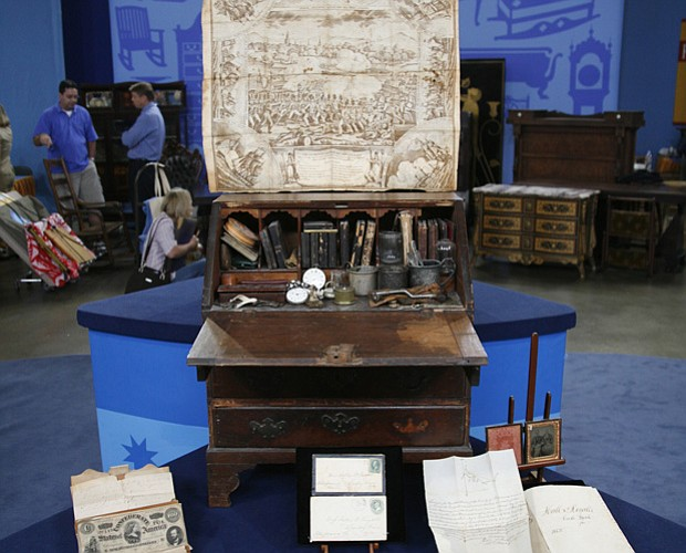 This rare desk, passed down through generations of the owner's family, contai...