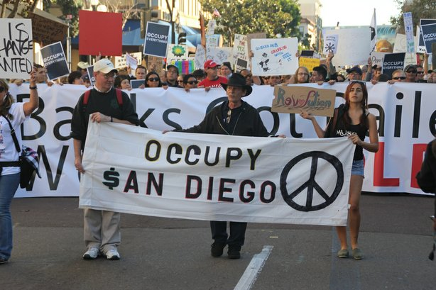 Protesters march to Civic Plaza during Occupy San Diego on Friday, October 7,...