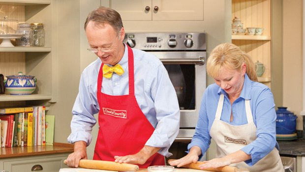 Host Chris Kimball baking with chef Bridget Lancaster in the test kitchen.