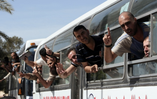 Palestinian prisoners pass the Rafah border crossing from Egypt into the Gaza Strip on Tuesday after they were released from Israeli jails as part of a landmark prisoner swap.