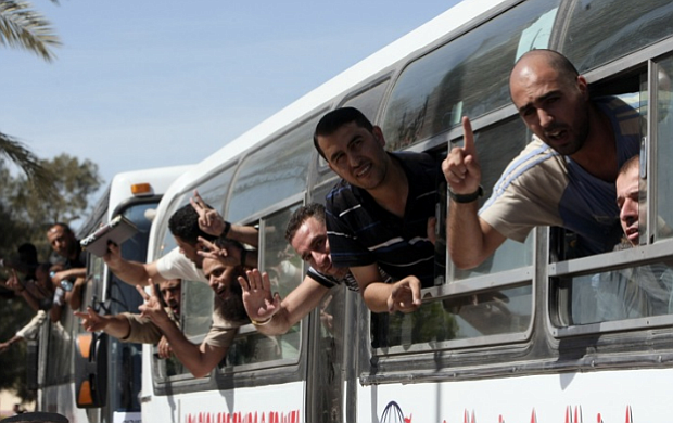 Palestinian prisoners pass the Rafah border crossing from Egypt into the Gaza...
