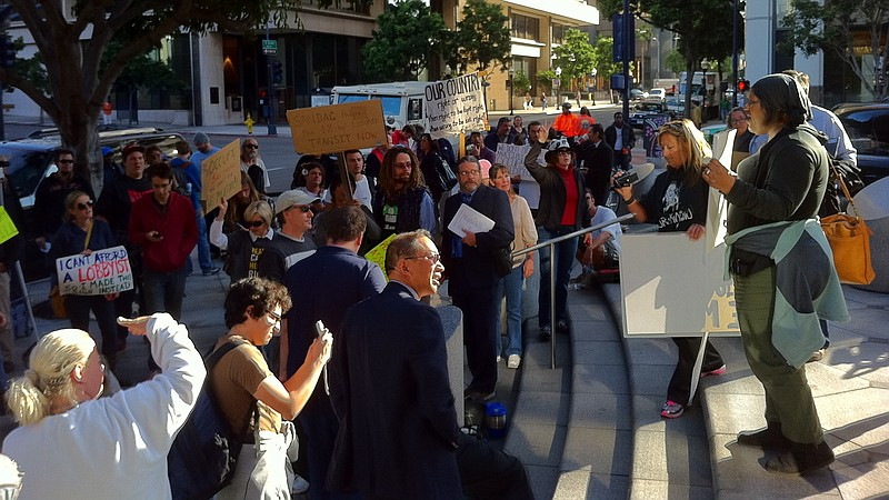 Occupy San Diego protesters regroup in front of a Wells Fargo bank in downtow...