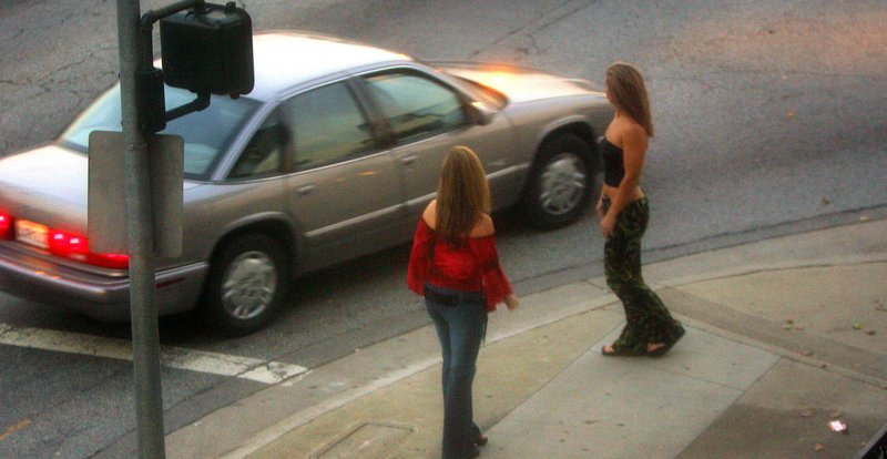 A car slows down for two female police officers posing as prostitutes in sout...