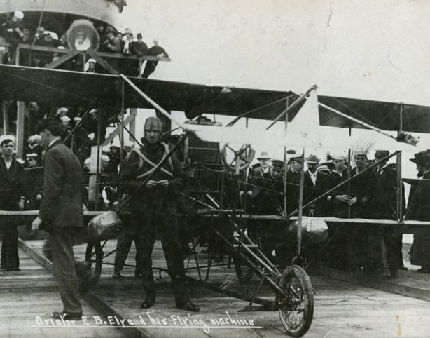 In 1911, Eugene Ely becomes the first to lift off and land on the deck of a aircraft carrier.