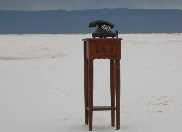 "A telephone in the middle of a desert is used to illustrate how mathematical anomalies that plagued string theory for years yield bizarre results in ""The Elegant Universe."""