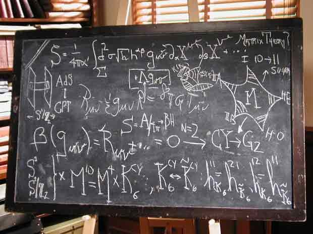 Equations for string theory and general relativity are displayed on a blackbo...